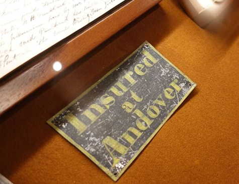 "Old metal sign with text ""Insured at Andover"""